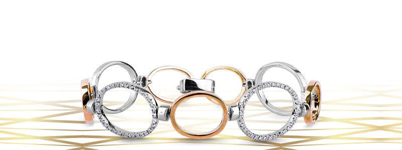 bracciale-in-oro-bianco-e-rosso-18k-con-elementi-di-forma-ovale-alternati-con-diamanti-TUBR4267RB-gioielli-di-valenza