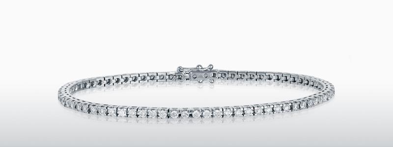 DTENQ03B-bracciale-tennis-in-oro-bianco-18k-con-diamanti-gioielli-di-valenza-